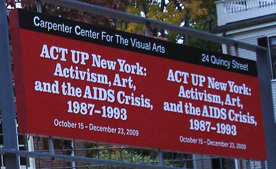 Below amp right sign and poster outside the museum entrance announcing